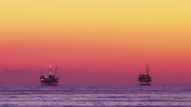 Offshore Oil Rig Drilling Platforms at Sunset (Time-lapse) video