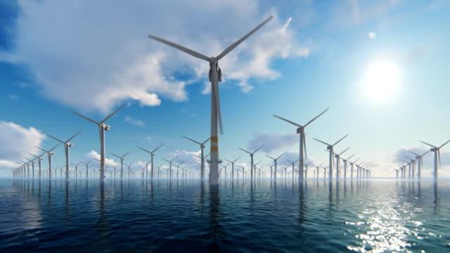 offshore windmills against beautiful clouds, 4k - attrezzatura industriale video stock e b–roll
