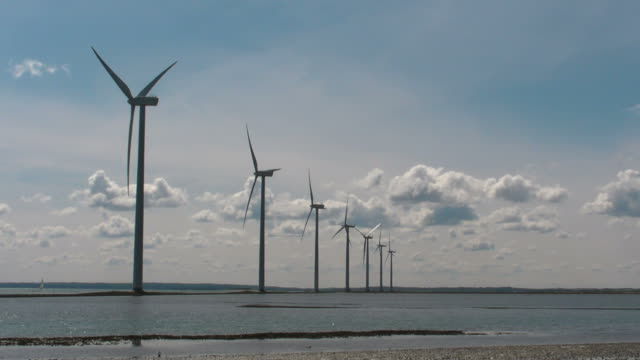 Offshore windmills rotates quickly video