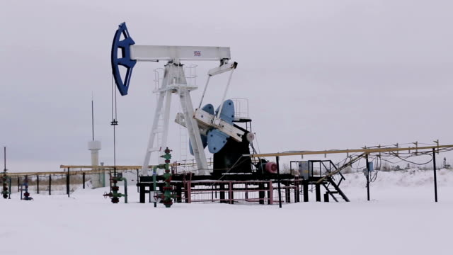 Oil and gas industry. Work of oil pump jack on a oil field video