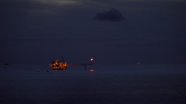 oil and gas production platform in the ocean at the night time video