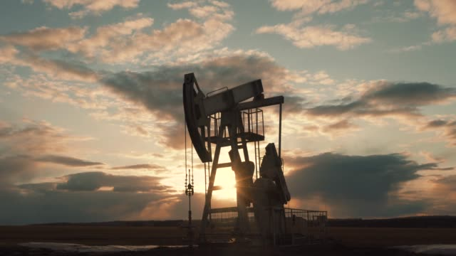 oil and gas production Technological oil and gas production. Production, transportation and processing of oil and gas. Production for the world's population. crane construction machinery stock videos & royalty-free footage