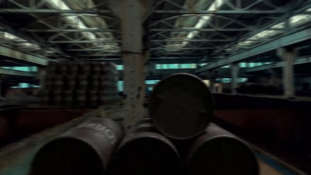 Oil barrel at an abandoned factory - Loopable video