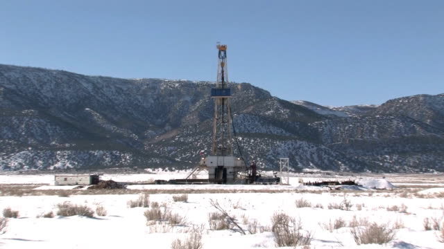 Oil drilling rig mountain close zoom in video