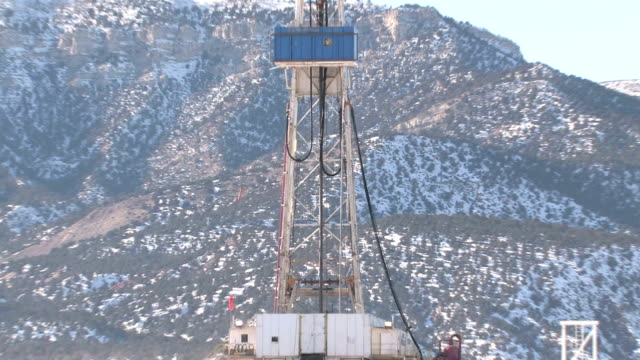 Oil drilling rig mountain zoom out video
