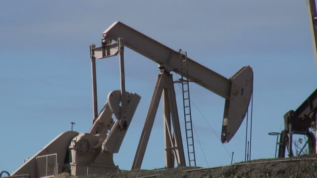 (HD1080i) Oil Exploration: Pumpjack Against Blue Sky video