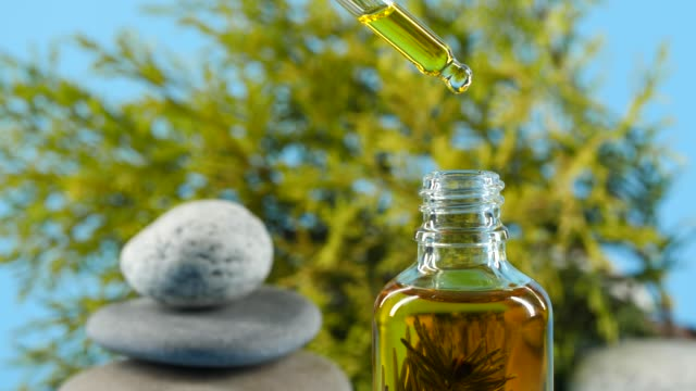 Oil from dropper Oil from dropper, herbal aromatherapy serum sample stock videos & royalty-free footage