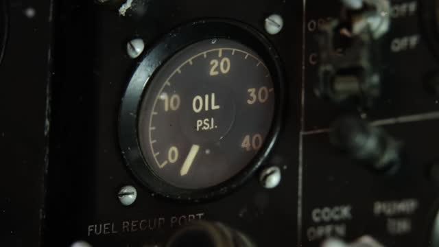 Oil Gauge inside an old Jet Fighter. Close-Up.