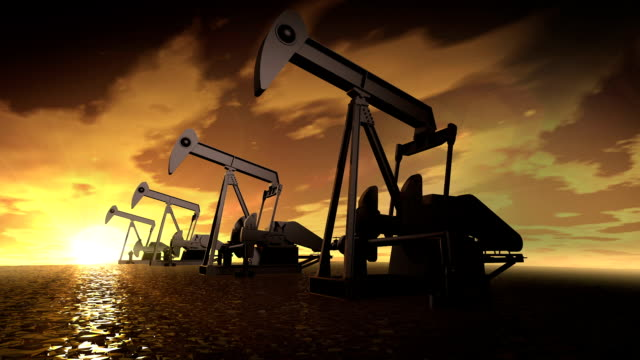 Oil industry pump. Oil donkeys producing oil at sunset video