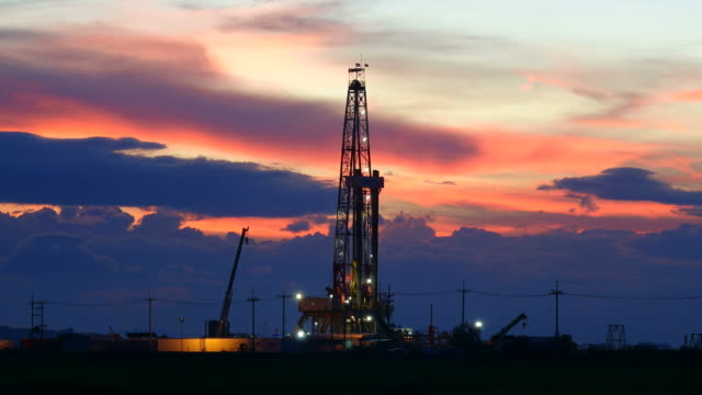 Oil industry sunset at oil industry in the field construction machinery stock videos & royalty-free footage