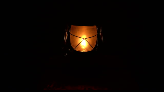 Oil lamp lit in the darkness. 4K. Oil lamp lit in the darkness. Shot in 4K (ultra-high definition (UHD)), so you can easily crop, rotate and zoom, without losing quality!  Real time. lantern stock videos & royalty-free footage
