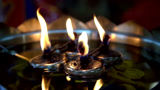 oil lamp with flame in thai temple in slow motion. - buddha video stock e b–roll