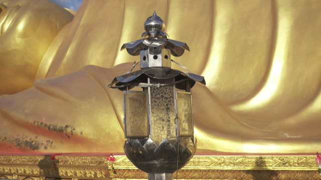 4K DOLLY : Oil lantern in place of worship video
