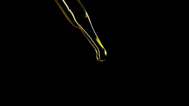 СBD oil many drops in a dropper from medical marijuana on a black background СBD oil many drops in a dropper from medical marijuana on a black background cannabidiol stock videos & royalty-free footage