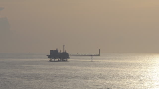 oil platform during sunset video