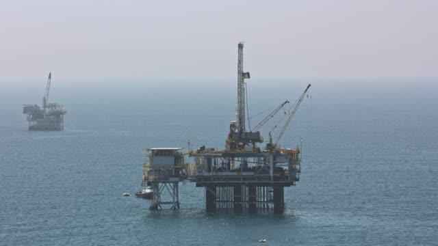 AERIAL Oil platforms in the ocean in California