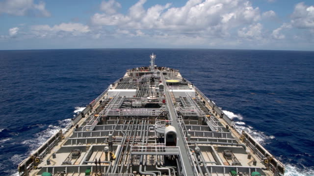 oil product tanker steaming in the ocean - time laps. - nave cisterna video stock e b–roll