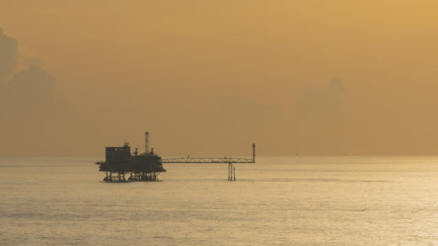 oil production platform, dusk to night video