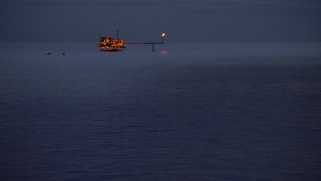 oil production platform in the ocean night time video