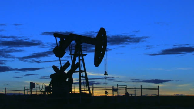 Oil pump at dusk video