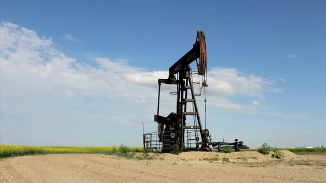 Oil Pump On Canadian Prairies A faithful oil pump works tirelessly on the Canadian prairies. prairie stock videos & royalty-free footage