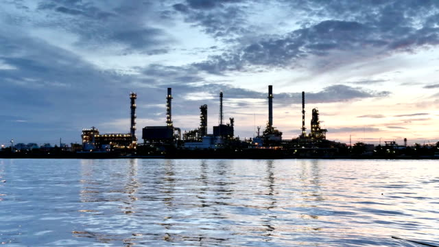 Oil refinery at twilight, Time lapse video