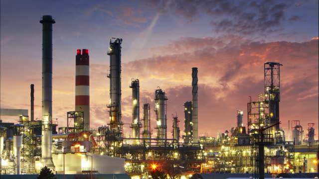 Oil refinery at twilight - Time lapse video