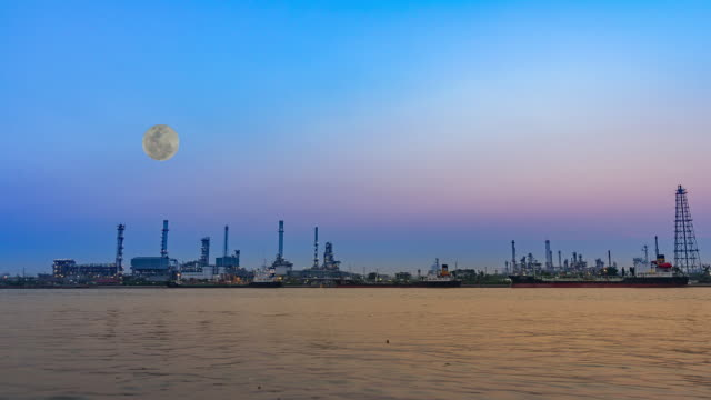 Oil refinery factory at full moon video