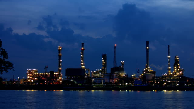 oil refinery  in night to sunrise . - gulf coast states stock videos & royalty-free footage