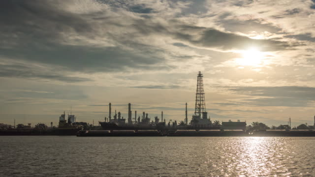 Oil refinery is working at sunrise video