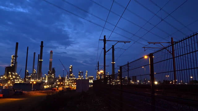 Oil refinery just after sunset, petrochemical plant.