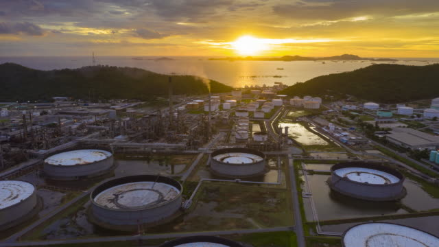 oil refinery plant chemical factory industrial footage 4K UHD resolution drone Hyperlapse of oil refinery plant chemical factory and power plant with many storage tanks and pipelines at sunset. biofuel stock videos & royalty-free footage