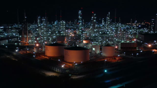 Oil refinery plant form industry zone, Aerial view oil and gas industrial, Refinery factory oil storage tank and pipeline steel at night. Oil refinery plant form industry zone, Aerial view oil and gas industrial, Refinery factory oil storage tank and pipeline steel at night. storage tank stock videos & royalty-free footage