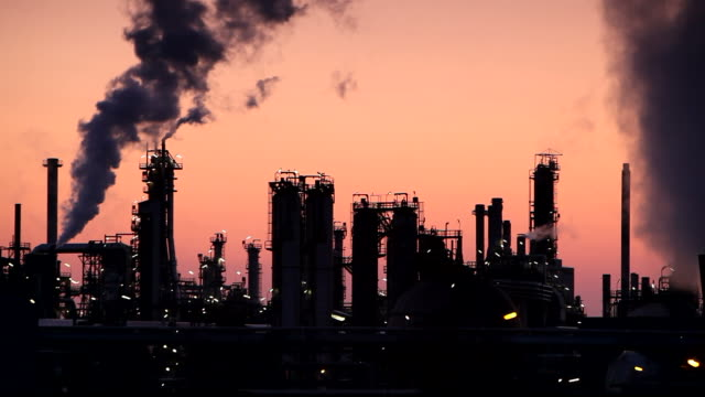 Oil refinery with smoke stack - Time lapse video video
