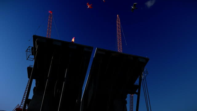Oil Rig against blue sky, cam fly video