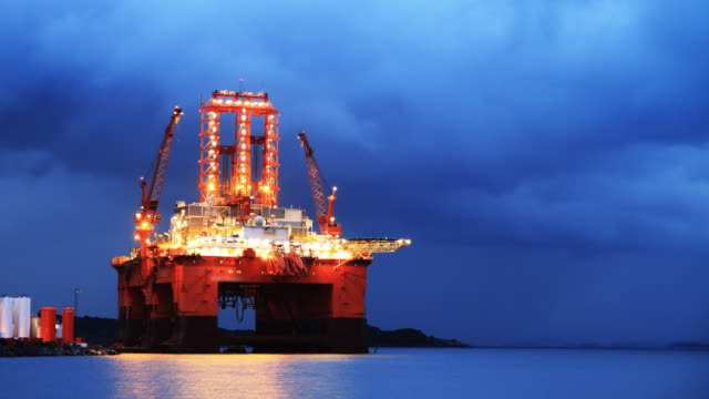 Oil rig in night timelapse video