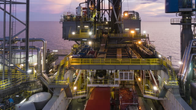oil rig operation - night to day, time lapse oil rig operation - night to day, zoom out, time lapse oil and gas stock videos & royalty-free footage