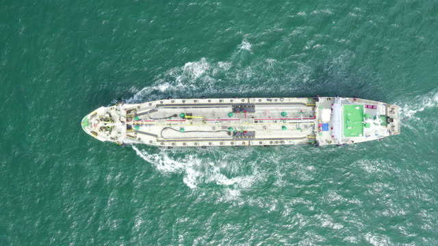 oil ship tanker on the sea to oil refinery for transportation or energy concept background - nave cisterna video stock e b–roll