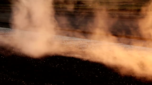 vídeos de stock e filmes b-roll de oil spreader truck applying tack coats on a surface in preparation for paving - alfalto