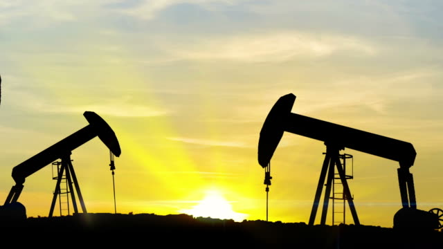 Oil well piston pumps at sunset, Pumping Jack - HD Stock Video video