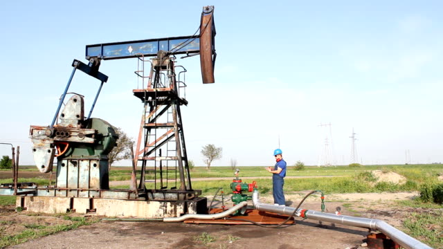 oil worker check pump jack video