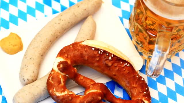 oktoberfest white sausage pretzel - oktoberfest stock videos and b-roll footage