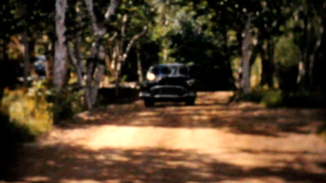 Old 1956 Car Driving On Country Road-Vintage 8mm film video