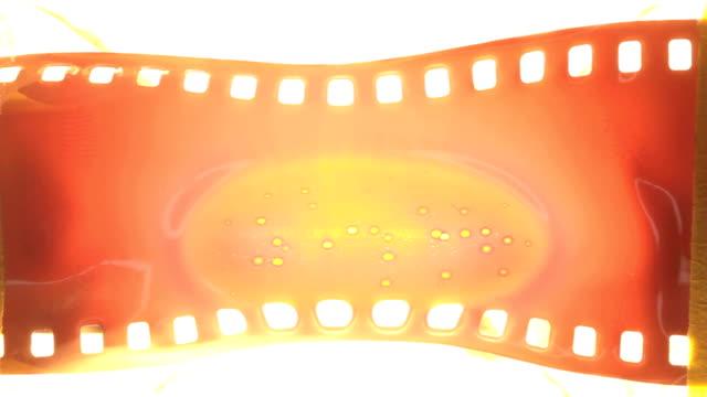 vídeos de stock e filmes b-roll de old 35 mm film melting - inflamável