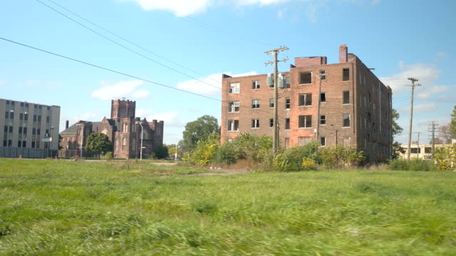 POV: Old abandoned block of flats in decaying industrial part of Detroit city video