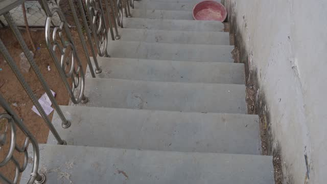 Old ancient marble stairs to come down to ground floor. Go down concept from roof to ground.