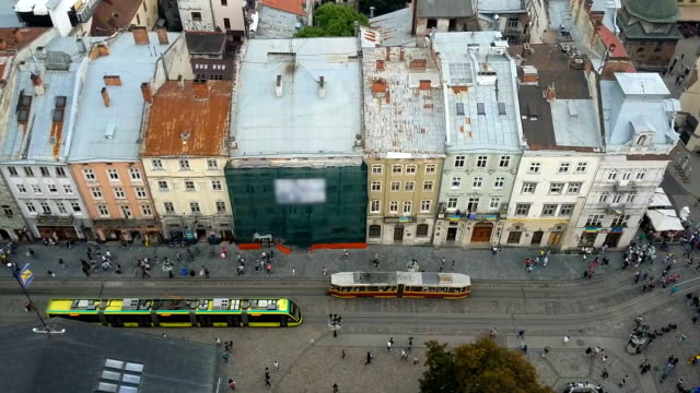Old and modern trams moving in Lviv narrow street, past intersecting with future video