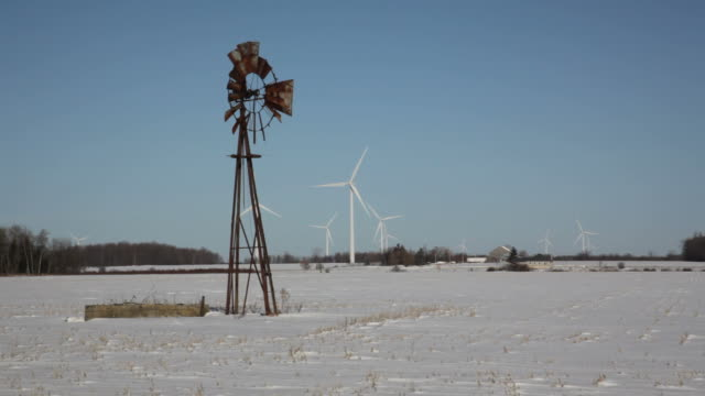 stockvideo's en b-roll-footage met old and new wind mill - s