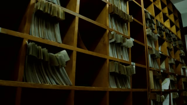 Old archive Old archive with tall wooden shelves storage room stock videos & royalty-free footage