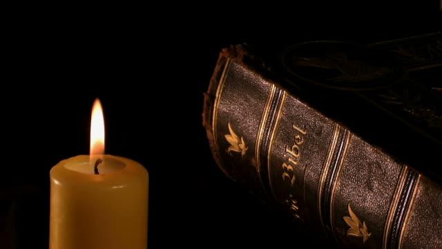 stockvideo's en b-roll-footage met old bible and candles - minder dan 10 seconden
